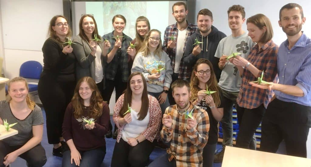 Students at Worcester University proudly show off their peace cranes