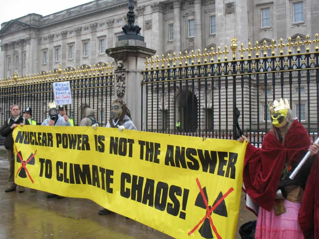 Group of protesters holding an anti-nuclear power banner