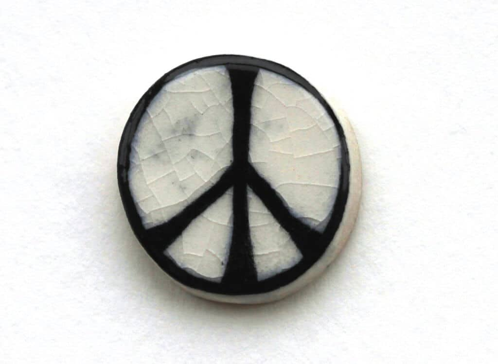 As made by Eric Austen, the first badge featuring the CND logo